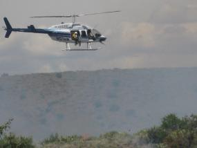 helicopter with guy looking at a fire